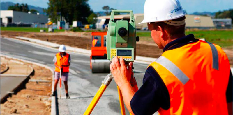 Professional surveyors on field