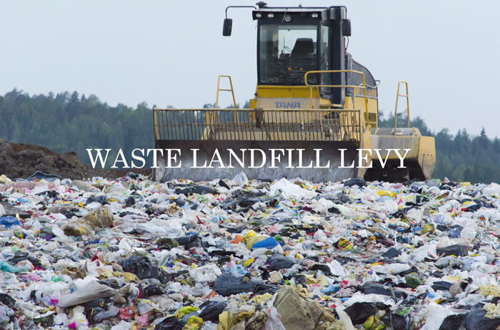 Garbage bulldozer working in a landfill - Harbak Business Advisory and Consultancy